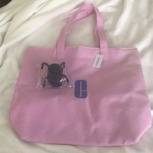 ONE Tagvo umbrella hook and Clinique tote